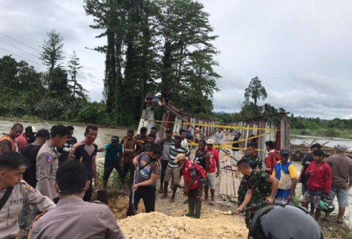 Repairing bridge in Arsotami village
