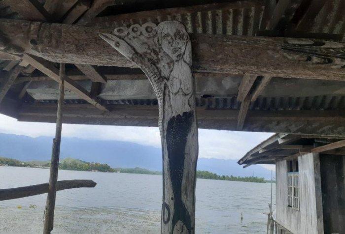 carving of a mermaid motif